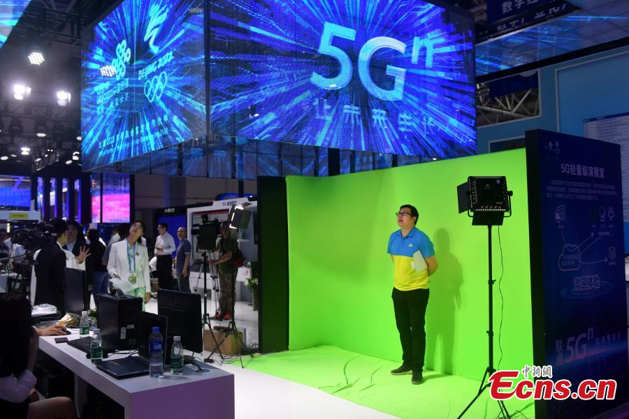 An exhibition booth of China Unicom shows the 5G-empowered studio at the second Digital China Summit in Fuzhou, Fujian Province, May 5, 2019. (Photo: China News Service/Lyu Ming)
