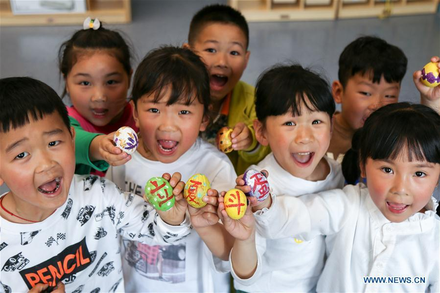 Children show painted eggs to mark the upcoming \