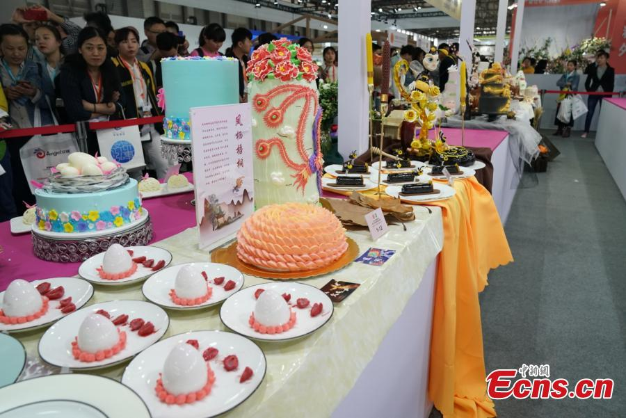 Participants compete in the 20th National Baking Skills Competition held at the Shanghai New International Expo Center, May 6, 2019. Eighty bakers from across the country took part in the competition organized by the China Association of Bakery and Confectionery Industry as well as other career guidance and industrial agencies. (Photo: China News Service/Wang Xin)