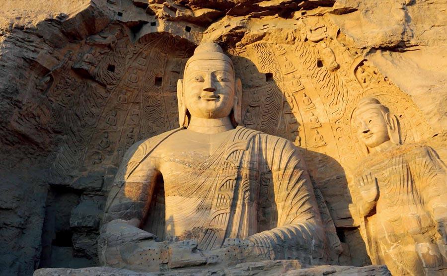 Buddha statues at Yungang Grottoes in Datong city, Shanxi Province.  (Photo provided to chinadaily.com.cn)