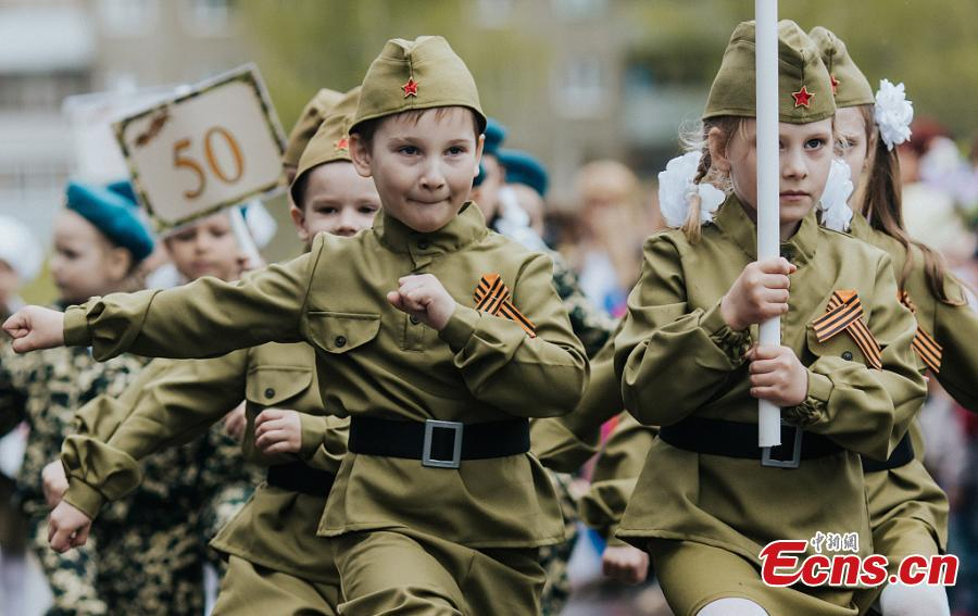 Children marched through the streets in military uniforms during a parade to celebrate the upcoming 74th Victory Day in Ivanovo, Russia, May 7, 2019. (Photo/VCG)