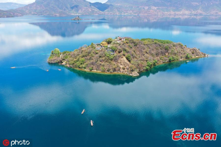 Photo taken on May 7, 2019 shows the natural scenery of the Lugu Lake between the Ninglang county of Yunnan Province and the Yanyuan county of Sichuan Province. (Photo/IC)