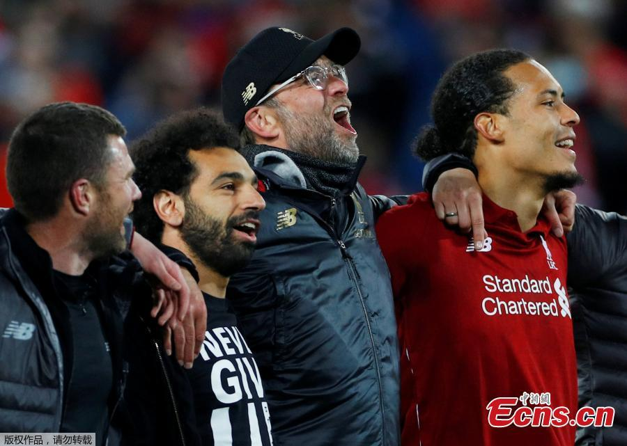 Liverpool\'s Mohamed Salah (2nd, L), manager Jurgen Klopp (2nd, R) and Virgil van Dijk (1st, R) celebrate after the UEFA Champions League Semi-Final second Leg match between Liverpool FC and FC Barcelona at Anfield in Liverpool, Britain on May 7, 2019. Liverpool won 4-3 on aggregate and reached the final. (Photo/Agencies)