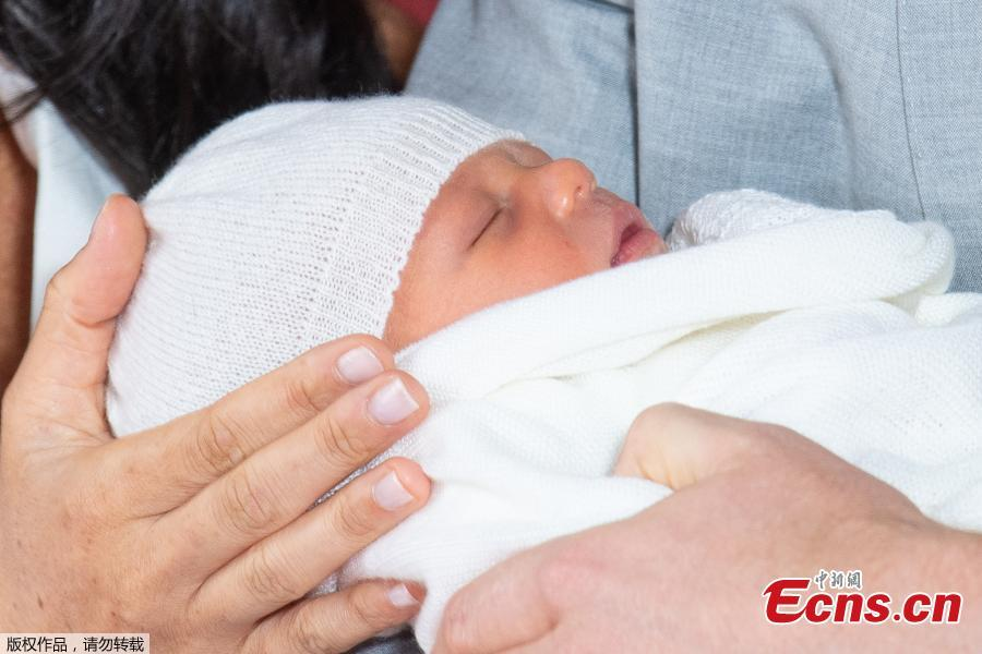 Photo taken on May 8, 2019 shows the son of Britain\'s Prince Harry, Duke of Sussex, and his wife Meghan Markle, Duchess of Sussex, in St George\'s Hall at Windsor Castle in Windsor, Britain. The baby boy, who is Queen Elizabeth\'s eighth great-grandchild, is seventh in line to the throne, behind the Prince of Wales, the Duke of Cambridge and his children - Prince George, Princess Charlotte and Prince Louis - and Prince Harry.