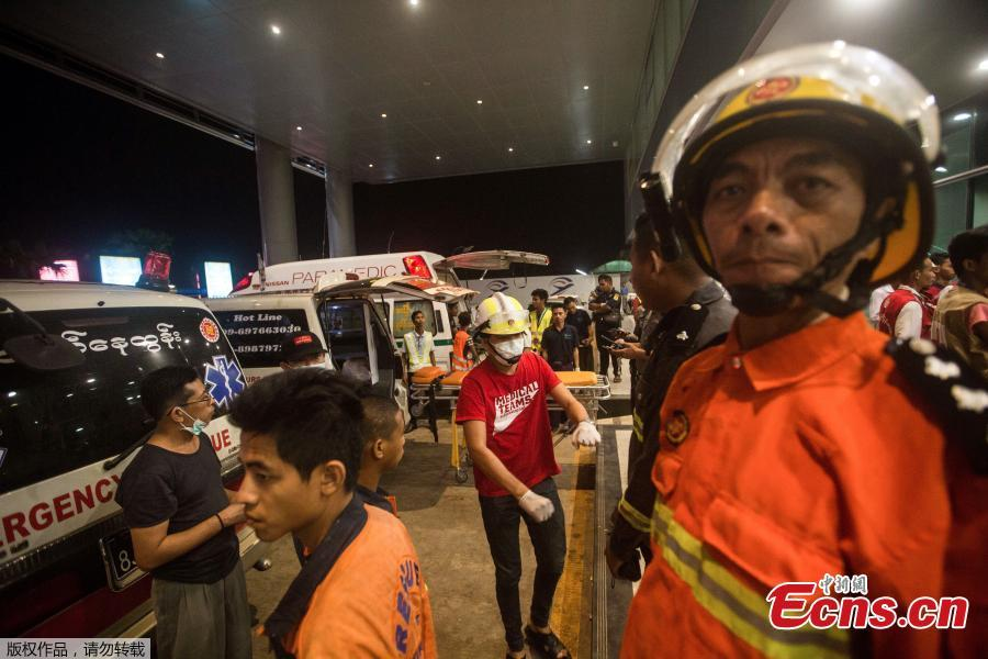 Rescuers gather at the Yangon International Airport in Yangon, Myanmar, May 8, 2019. Some 18 people including five crew members were injured after a passenger plane of the Biman Bangladesh airlines skidded off the runway at Myanmar\'s Yangon International Airport (YIA) on Wednesday, said the Department of Civil Aviation Myanmar.  (Photo/Agencies)