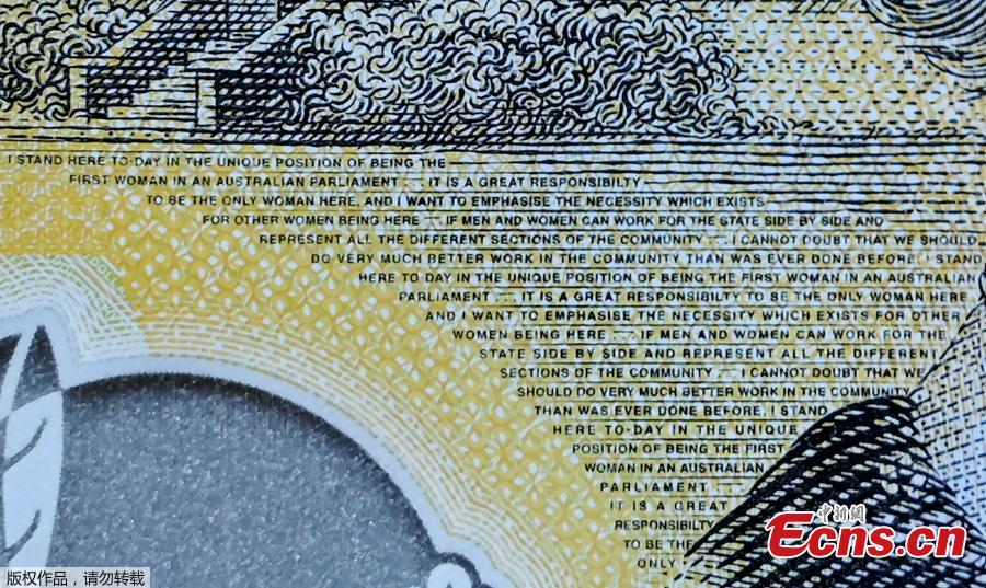 This photo illustration shows the detail in Australia\'s state-of-the-art new 50 dollar banknote in Sydney on May 9, 2019, with a spelling mistake in the microprint of a speech by Australia\'s first woman parliamentarian Edith Cowan. The yellow and green note came into circulation last October, but it took seven months for the public to notice \