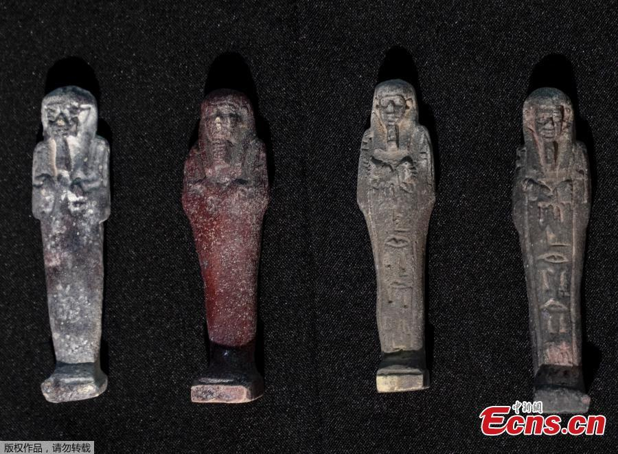 Recovered Shabits, mummy-liked statues, are presented to the media by the National Museum during a news conference in Rio de Janeiro, Brazil, Tuesday, May 7, 2019. Brazil\'s national museum said Tuesday it has recovered 200 pieces from its 700 pieces Egypt collection, the largest in Latin America, after a devastating fire in September 2018.