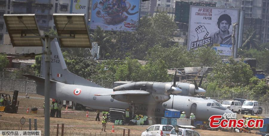 An Indian Air Force transport aircraft that overshot the runway Tuesday night sits on an unpaved surface at the Chhatrapati Shivaji Maharaj International Airport in Mumbai, India, Wednesday, May 8, 2019. Efforts are underway to move the aircraft from the unpaved surface and the same was expected to be accomplished soon, officials said. (Photo / Agencies)