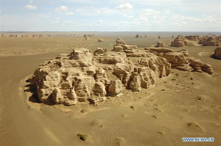 Aerial photo taken on May 8, 2019 shows the scenery of Dunhuang Yardang National Geopark after a rain in Dunhuang, northwest China\'s Gansu Province. (Xinhua/Fan Peishen)