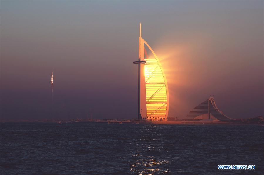 Photo taken on Dec. 30, 2016 shows the hotel Burj Al-Arab, literally Arabian tower, in Dubai, the United Arab Emirates. China will hold the Conference on Dialogue of Asian Civilizations starting from May 15. Under the theme of \