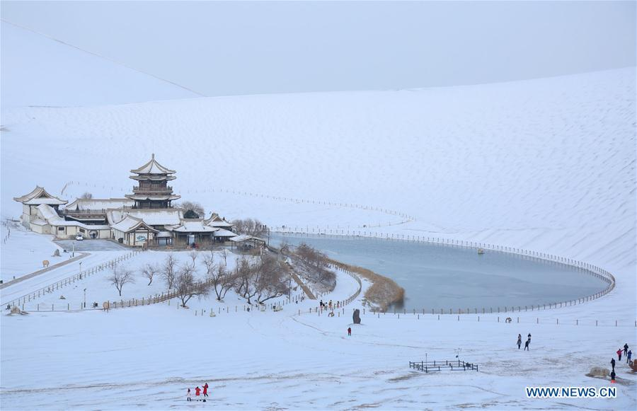 Photo taken on Dec. 2, 2018 shows the snow scenery of the Mingsha Mountain and Crescent Spring scenic area in Dunhuang, northwest China\'s Gansu Province. China will hold the Conference on Dialogue of Asian Civilizations starting from May 15. Under the theme of \