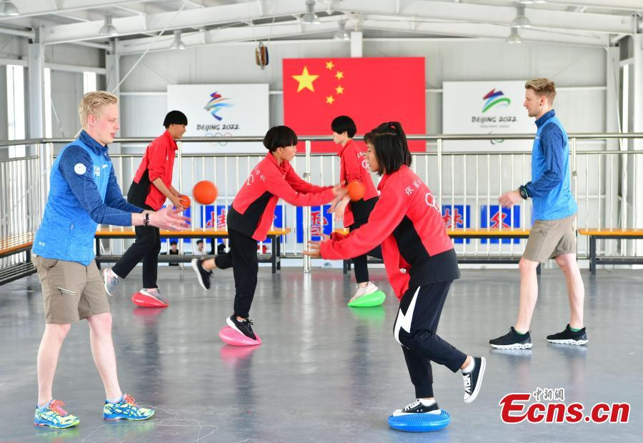 Students train at the Youth Winter Olympic Sports School, or Xuanhua No. 2 Middle School, in Zhangjiakou, Hebei Province, May 9, 2019. The school established in 2015 is the only of its kind to specialize on training of Winter Olympic sports in China. The school has recruited more than 1,200 students, including 200 trained to be competitive skiers. Located some 200km northwest of Beijing, Zhangjiakou will host snowboarding, freestyle skiing, cross-country skiing, ski jumping, Nordic combined and biathlon competitions during the 2022 Winter Games. (Photo: China News Service/Zhai Yujia)