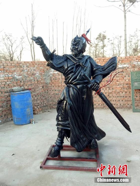 Cao Shengge shows his homemade sculptures made out of used tyres in Xingtai City, Hebei province. Cao became interested in making sculptures with tyres in 2015. He has recycled nearly 50 tons of otherwise waste tyres to create about 100 works, including mythical figures, beasts, and the twelve zodiac animals. He said the tyres usually needed to be cut into pieces and then put together to form a creation, a process that may take tens of days. Cao also said he hopes to organize an exhibition of his works and promote public awareness of environmental protection. (Photo provided to China News Service)