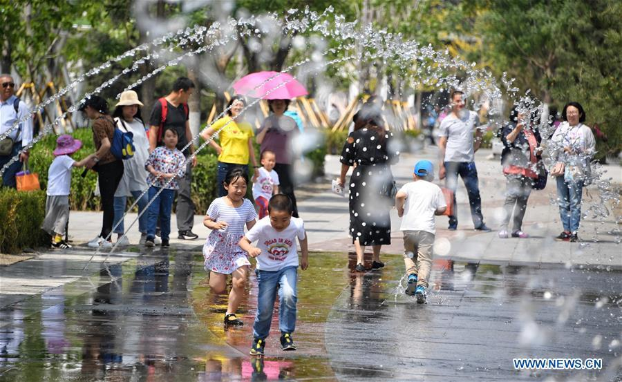 Kids play during the Beijing International Horticultural Exhibition in Yanqing District of Beijing, capital of China, May 10, 2019. The Beijing International Horticultural Exhibition has welcomed a large number of tourists from home and abroad since the opening. As of May 9, it has seen more than 500,000 visitors, according to the Beijing International Horticultural Exhibition Coordination Bureau. (Xinhua/Li Xin)