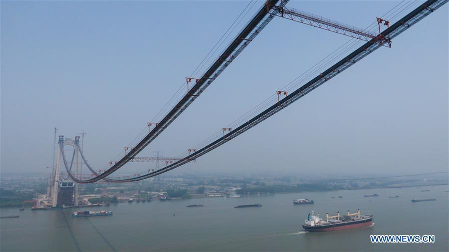 Aerial photo shows the construction site of the Wufengshan Yangtze River Bridge in Zhenjiang, east China\'s Jiangsu Province, May 10, 2019. Some 704 main cable strands for the bridge, a part of the Lianyungang-Zhenjiang railway, were successfully erected Friday in Jiangsu, marking the erection of China\'s first road-rail suspension bridge\'s main cable was finished. The bridge is scheduled to be completed within 2019 and open to traffic by 2020. (Xinhua/Li Xiang)