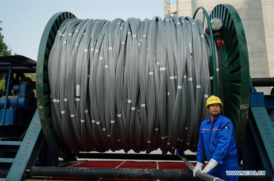 A worker is seen at the construction site of the Wufengshan Yangtze River Bridge in Zhenjiang, east China\'s Jiangsu Province, May 10, 2019. Some 704 main cable strands for the bridge, a part of the Lianyungang-Zhenjiang railway, were successfully erected Friday in Jiangsu, marking the erection of China\'s first road-rail suspension bridge\'s main cable was finished. The bridge is scheduled to be completed within 2019 and open to traffic by 2020. (Xinhua/Li Xiang)