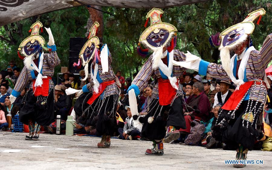 Troupers perform Tibetan Opera at Dzongyab Lukhang Park in Lhasa, capital of southwest China\'s Tibet Autonomous Region, Aug. 16, 2015. China will hold the Conference on Dialogue of Asian Civilizations starting from May 15. Under the theme of \