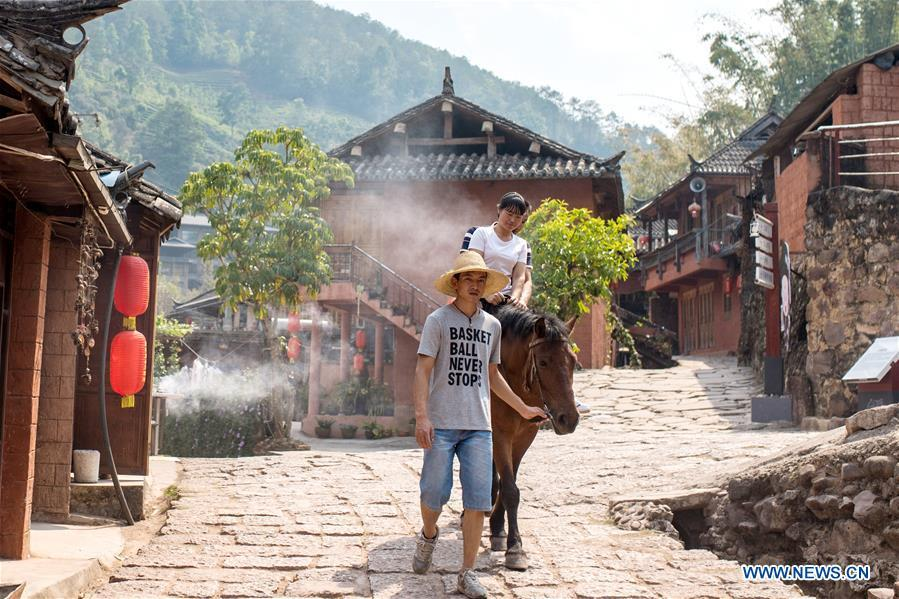Visitors experience horse riding in Tongxin Township, once a stop along the ancient Tea Horse Road, in Hani and Yi Autonomous County of Ning\'er, Pu\'er City, southwest China\'s Yunnan Province, on April 14, 2019. As an important part of Asian culture, tea is a special bond among Asian countries to deepen friendship and boost mutual exchanges. China will hold the Conference on Dialogue of Asian Civilizations starting from May 15. Under the theme of \