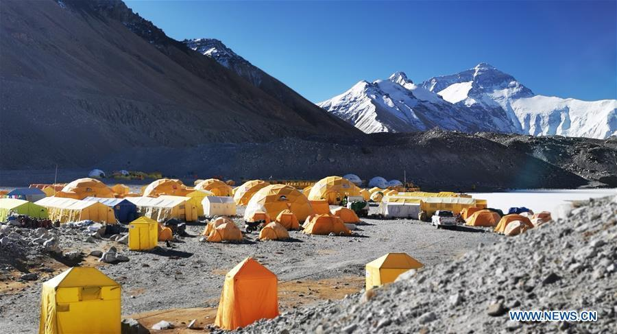 Photo taken on April 29, 2019 shows the base camp of the northern face of Mount Qomolangma in southwest China\'s Tibet Autonomous Region. Every year, for a few weeks, hundreds of climbers and supporting personnel come to the base camp of the northern face of Mount Qomolangma, trying to reach the summit of the tallest and most famous mountain in the world. Before starting climbing, they need to hike several times between elevations from 5,000 meters to 7,000 meters, giving their bodies some time to adapt. When this process is over, it\'s all up to the weather. The base camp is a popular place to wait for the window. Among the six camps on the northern face, the base camp at an altitude of 5,200 meters is the furthest cars can reach and therefor the most equipped. Besides food and accommodation, climbers can also enjoy tea and massage. They can also play football on perhaps the highest field. There\'s even a simple gym in the camp. Environmental protection is a priority here. Garbage sacks are given to each climbing team. Special containers are put in every camp to collect trash and sewage. The collected trash must be treated 100 kilometers away, and the only road is a zigzagging track. It is not trucks, but yaks that are generally used to make the journey. Actually yaks are vital on the mountain. Beyond the base camp, yak is the only reliable transport. (Xinhua/Zhaxi Tsering)