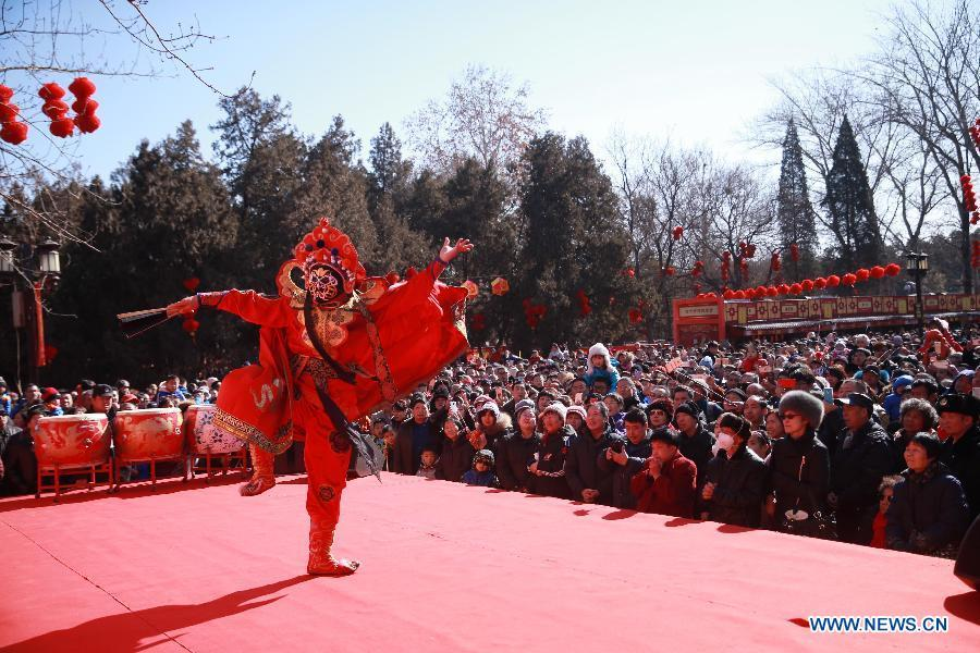 A folk artist performs Sichuan Opera face-changing during a Spring Festival temple fair at Ditan Park in Beijing, capital of China, Feb. 16, 2018. China will hold the Conference on Dialogue of Asian Civilizations starting from May 15. Under the theme of \