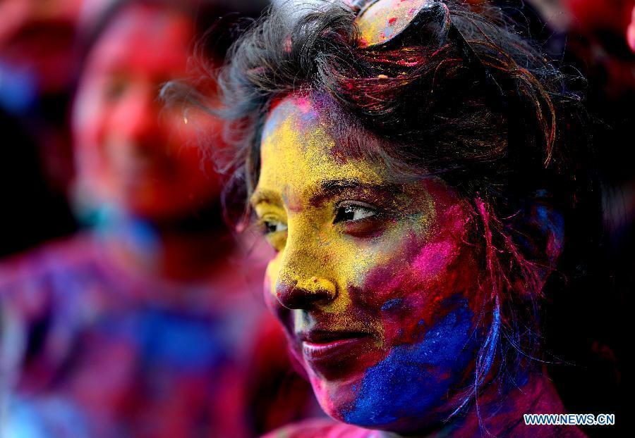 Women with their faces smeared with colored powder take part in a celebration of the Holi Festival in Yangon, Myanmar, March 20, 2019. China will hold the Conference on Dialogue of Asian Civilizations starting from May 15. Under the theme of \