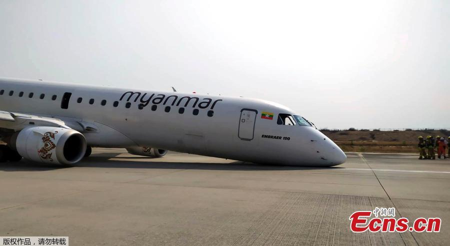 A Myanmar National Airlines flight to Mandalay International Airport makes an emergency landing without its front landing gear, May 12, 2019. No one on the plane was injured. (Photo/Agencies)