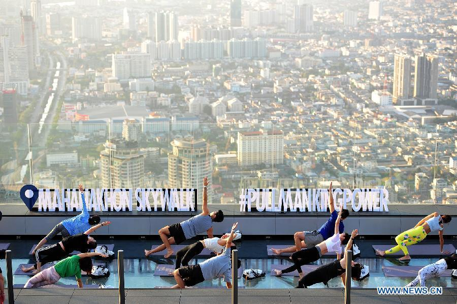 People practice yoga at an observation deck on the rooftop of a skyscraper in Bangkok, capital of Thailand, Feb. 19, 2019. China will hold the Conference on Dialogue of Asian Civilizations starting from May 15. Under the theme of \