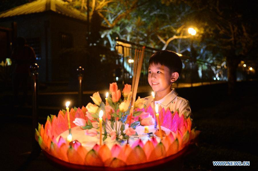 A boy holds a water lantern in Bandar Seri Begawan, capital of Brunei, Nov. 22, 2018. China will hold the Conference on Dialogue of Asian Civilizations starting from May 15. Under the theme of \