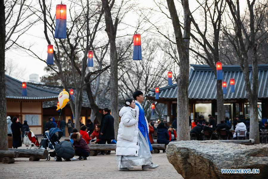 Tourists dressed in traditional costume visit a folklore-themed village in Yongin, South Korea, Feb. 5, 2019. China will hold the Conference on Dialogue of Asian Civilizations starting from May 15. Under the theme of \