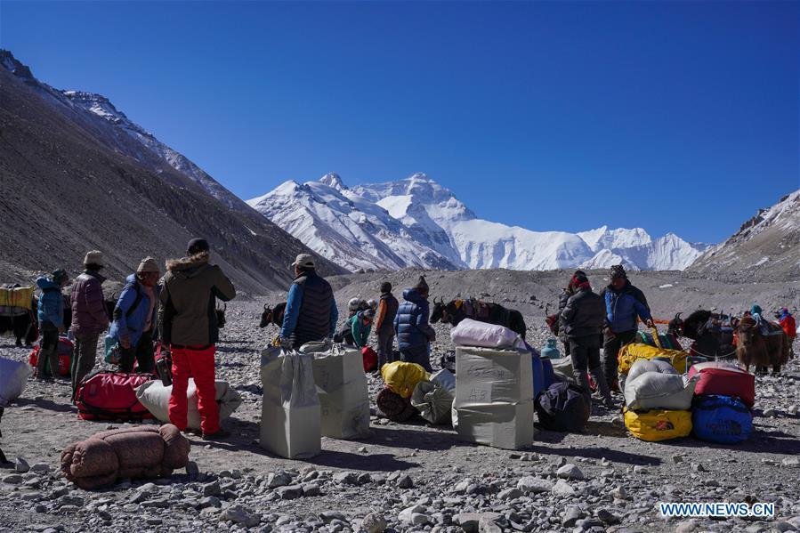 Goods and materials are to be transported to the camps at higher altitude for the climbers on the northern face of Mount Qomolangma in southwest China\'s Tibet Autonomous Region, April 25, 2019. Every year, for a few weeks, hundreds of climbers and supporting personnel come to the base camp of the northern face of Mount Qomolangma, trying to reach the summit of the tallest and most famous mountain in the world. Before starting climbing, they need to hike several times between elevations from 5,000 meters to 7,000 meters, giving their bodies some time to adapt. When this process is over, it\'s all up to the weather. The base camp is a popular place to wait for the window. Among the six camps on the northern face, the base camp at an altitude of 5,200 meters is the furthest cars can reach and therefor the most equipped. Besides food and accommodation, climbers can also enjoy tea and massage. They can also play football on perhaps the highest field. There\'s even a simple gym in the camp. Environmental protection is a priority here. Garbage sacks are given to each climbing team. Special containers are put in every camp to collect trash and sewage. The collected trash must be treated 100 kilometers away, and the only road is a zigzagging track. It is not trucks, but yaks that are generally used to make the journey. Actually yaks are vital on the mountain. Beyond the base camp, yak is the only reliable transport. (Xinhua/Sun Fei)