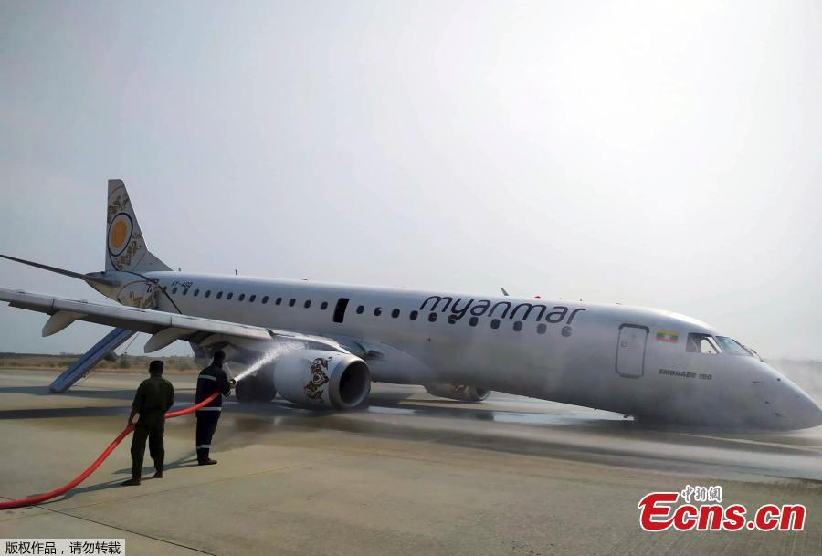 Rescue team gather near a plane of Myanmar National Airline (MNA) after an accident at Mandalay International airport Sunday, May 12, 2019, in Mandalay, Myanmar. (Photo/Agencies)