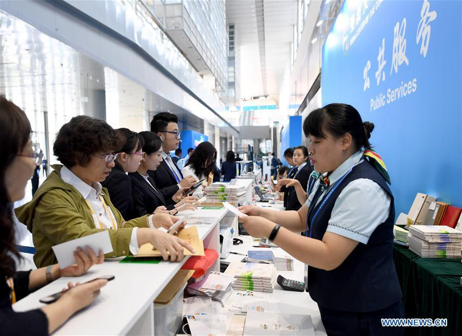 Reporters buy commemorative envelopes at the media center of the Conference on Dialogue of Asian Civilizations in the China National Convention Center in Beijing, capital of China, May 14, 2019. The Conference on Dialogue of Asian Civilizations will open on Wednesday. (Xinhua/Wang Yuguo)