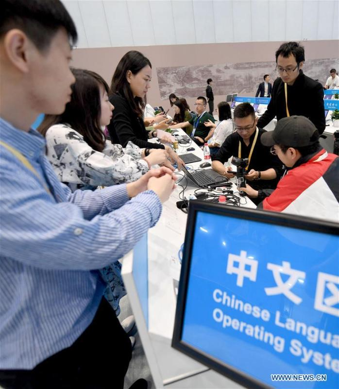 Reporters are seen at the media working area of the media center of the Conference on Dialogue of Asian Civilizations in the China National Convention Center in Beijing, capital of China, May 14, 2019. The Conference on Dialogue of Asian Civilizations will open on Wednesday. (Xinhua/Wang Yuguo)