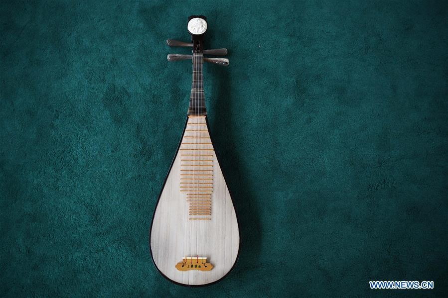 Pipa is pictured at Lanzhou traditional orchestra in Lanzhou, northwest China\'s Gansu Province, May 13, 2019. Pipa, a pear-shaped stringed instrument, is one of the traditional Chinese musical instruments. The pipa is played vertically and can be found in solos, ensembles or orchestras. The images of flying apsaras playing the pipa have been seen on murals in Gansu\'s Dunhuang Mogao Grottoes, a 1,600-year-old UNESCO world heritage site located at a cultural and religious crossroads area on the ancient Silk Road in Gansu. Nowadays contemporary dance performances inspired from those images on the murals have been staged times and times again. (Xinhua/Chen Bin)