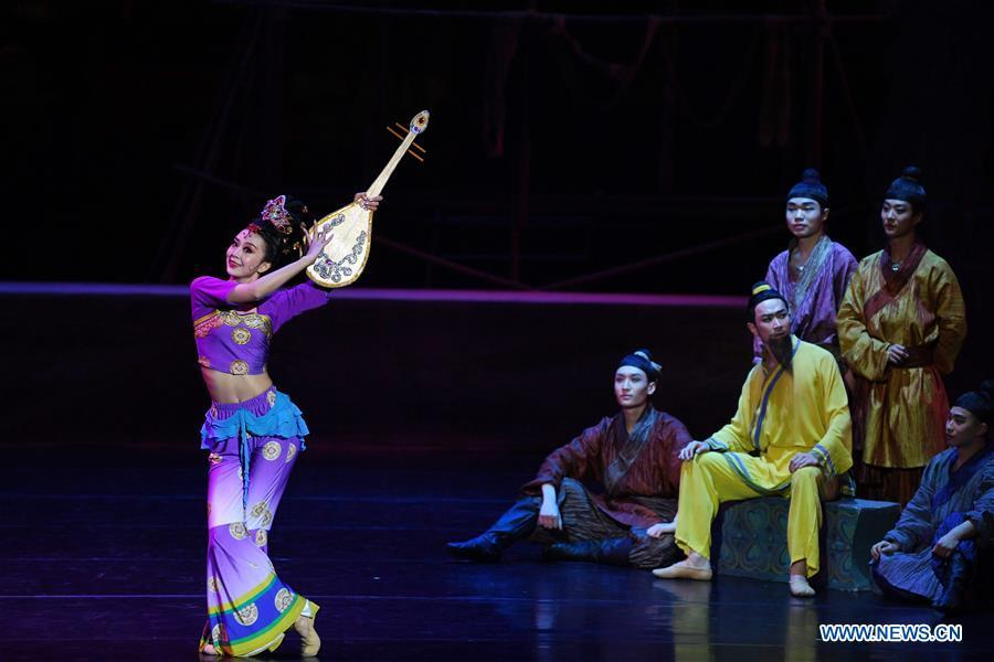 A performer holding the stage property of pipa dances during the Chinese classic dance drama \