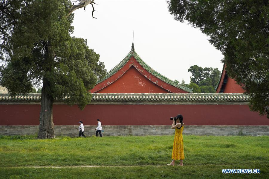 Feng Ganyu takes pictures at the Temple of Heaven in Beijing, capital of China, May 11, 2019. A photographic exhibition themed \