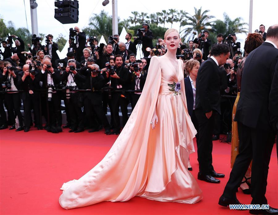Jury member Elle Fanning arrives on the red carpet for the opening gala during the 72nd Cannes Film Festival at Palais des Festivals in Cannes, France, on May 14, 2019. The 72nd Cannes Film Festival is held here from May 14 to 25. (Xinhua/Gao Jing)