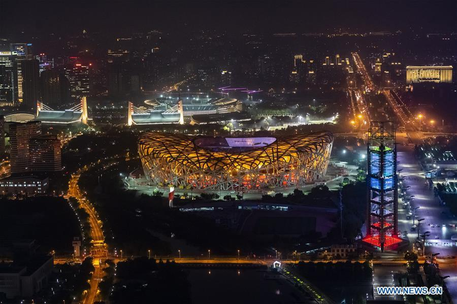 Photo taken on May 14, 2019 shows the night view of the National Stadium, also known as the Bird\'s Nest, in Beijing, capital of China. Roads and buildings were illuminated Tuesday evening before the upcoming Conference on Dialogue of Asian Civilizations (CDAC) in Beijing. (Xinhua/Shen Bohan)