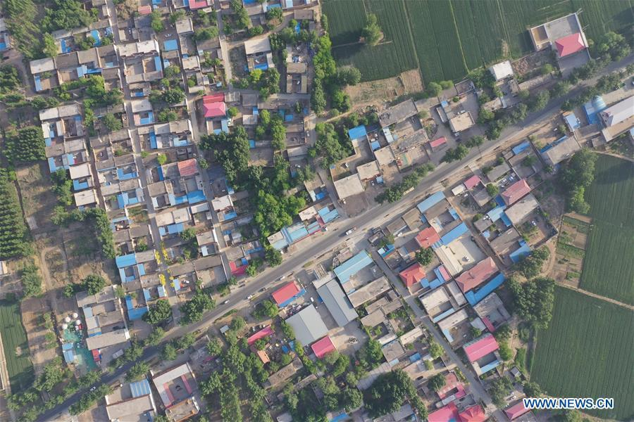 Aerial photo taken on May 14, 2019 shows the view of Gongzhuang Village of Bayu Township, Rongcheng County, Xiongan New Area, north China\'s Hebei Province. Relocation has officially started in Xiongan New Area, a new city in the making about 100 kilometers southwest of Beijing. A large-scale building phase will start this year at Xiongan, authorities said. A 13-sq-km residential area will be built in the east part of Rongcheng County. (Xinhua/Xing Guangli)