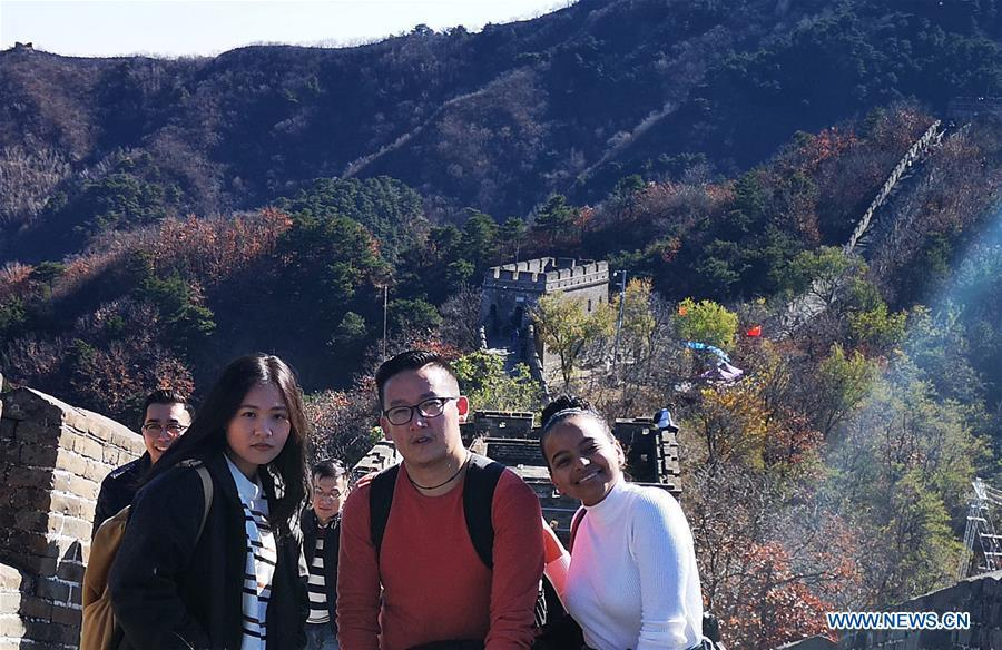 File photo taken in November of 2018 shows Sangay Tenzin (2nd R) posing for a photo with friends on the Great Wall in Beijing, capital of China. Sangay Tenzin, a Bhutanese student of Beijing Language and Culture University, is one of the photographers whose work was accepted by an exhibition themed \