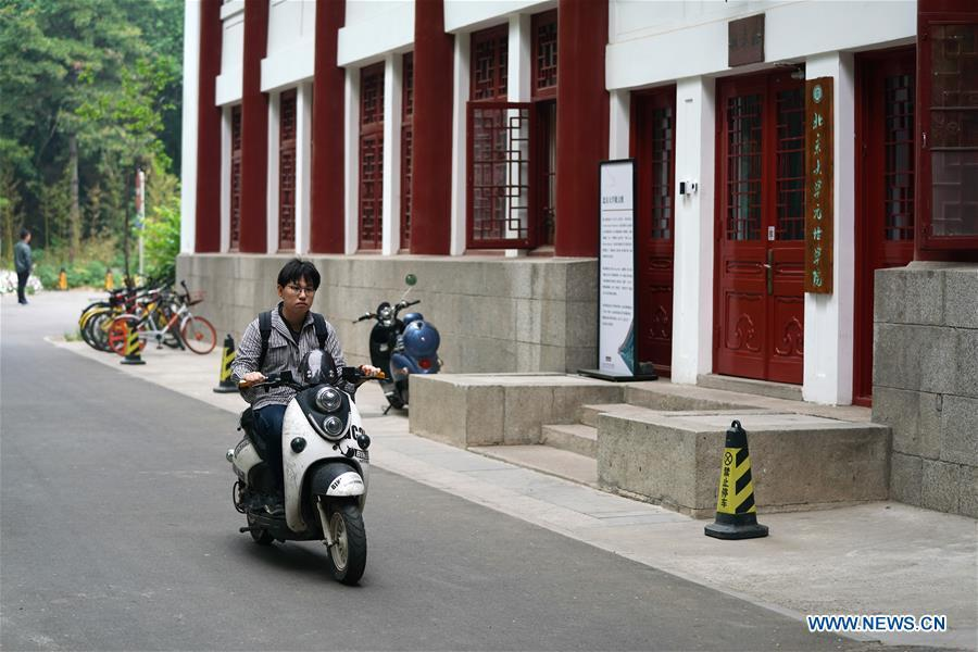 Ratjirot Aekkawat rides a scooter on the campus of the Peking University in Beijing, capital of China, May 12, 2019. Ratjirot Aekkawat is of mixed blood from China and Thailand. He came to study in China as a junior student and now he is a postgraduate student of the Peking University. He always talks about his experience in China with relatives and friends. He has witnessed the development of China in recent years, during which the environment and local governments\' working efficiencies have been greatly improved. Chinese and Thai cultures are influenced with each other. Many Thai people celebrate the Spring Festival every year and lots of Chinese go to Thailand for tourism. The photo of the historical site of Ayutthaya Dynasty taken by Ratjirot Aekkawat will be displayed in a photographic exhibition \