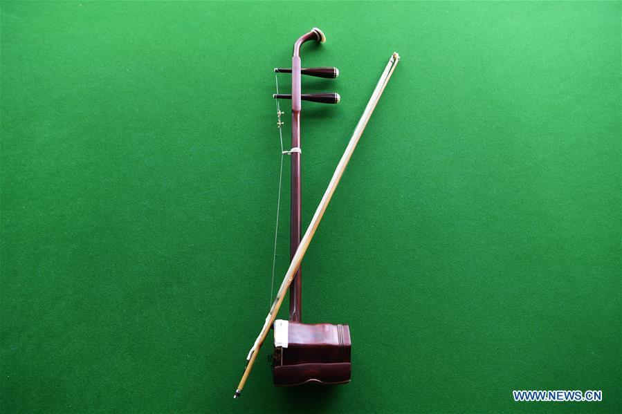 An Erhu is pictured in Lanzhou, northwest China\'s Gansu Province, May 13, 2019. Erhu, sometimes known as the Chinese violin or Chinese two-stringed fiddle, is a Chinese traditional two-stringed bowed musical instrument. It is used as a solo instrument as well as in small ensembles and large orchestras. Erhu, traced back to ancient Chinese Tang dynasty (618-907), is now used in both traditional and contemporary music arrangements, such as in pop, rock and jazz. The famous solo pieces include Er Quan Ying Yue (Two Springs Reflecting the Moon) by Abing and Sai Ma (Horse Race) by Huang Haihuai. (Xinhua/Fan Peishen)