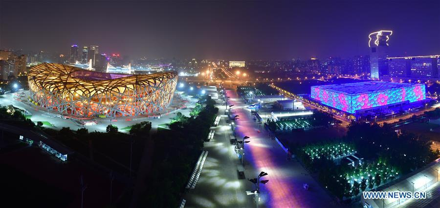 Photo taken on May 14, 2019 shows the night view of the National Stadium, also known as the Bird\'s Nest, and the National Swimming Center, also known as the Water Cube, in Beijing, capital of China. Roads and buildings were illuminated Tuesday evening before the upcoming Conference on Dialogue of Asian Civilizations (CDAC) in Beijing. (Xinhua/Li He)