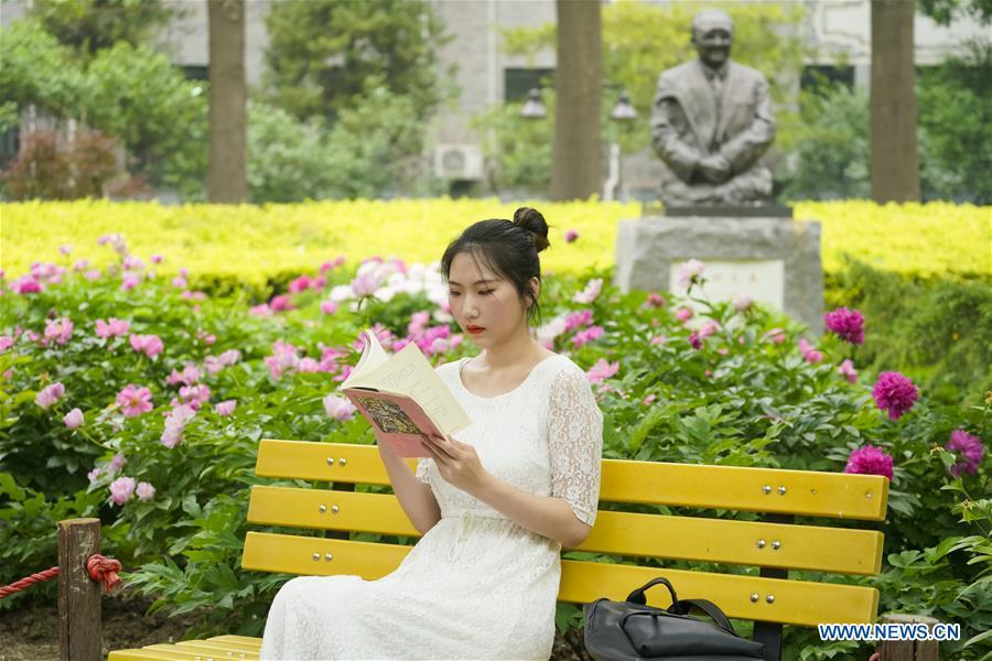 Feng Ganyu reads a book at Beijing Normal University in Beijing, capital of China, May 12, 2019. A photographic exhibition themed \