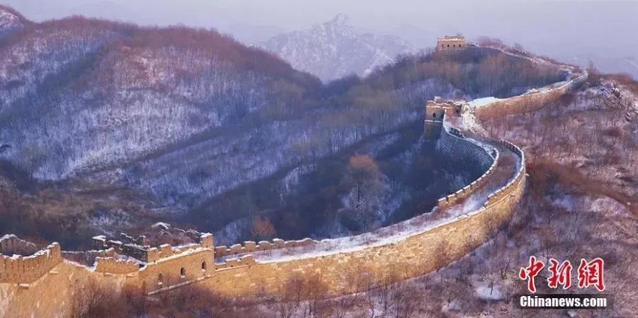 Photo shows the Mutianyu section of the Great Wall in Beijing. While today\'s Great Wall mostly date back to the Ming and Qing Dynasties, parts of the structure go back as early as 500 BCE.  (Photo/China News Service)