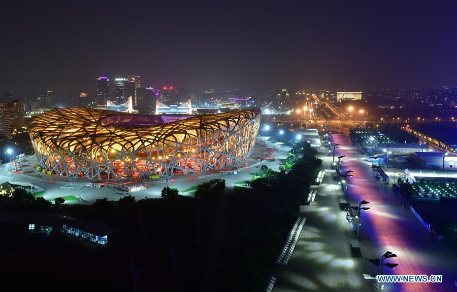 Photo taken on May 14, 2019 shows the night view of the National Stadium, also known as the Bird\'s Nest, in Beijing, capital of China. Roads and buildings were illuminated Tuesday evening before the upcoming Conference on Dialogue of Asian Civilizations (CDAC) in Beijing. (Xinhua/Li He)