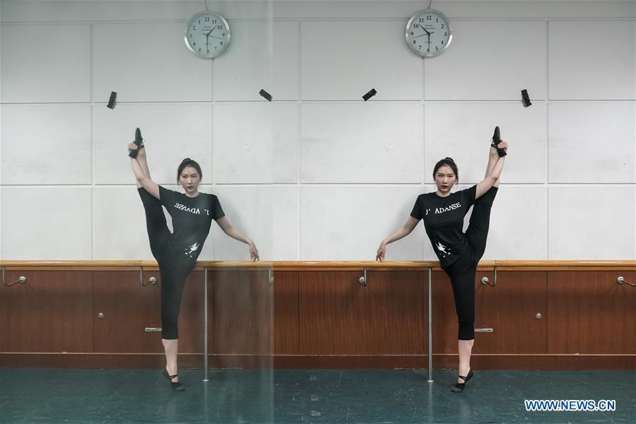 Feng Ganyu dances in a training room at Beijing Normal University in Beijing, capital of China, May 12, 2019. A photographic exhibition themed \