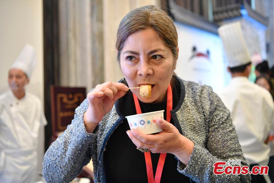 """Photo taken on May 14, 2019 shows the Chengdu Panda Asian Food Festival held in Chengdu City, Sichuan Province. Two hundred guests from many countries and regions were invited to enjoy the Tianfu Family Banquet that included 16 signature Sichuan dishes. Sichuan food has a long history and is known as one of the four major Chinese cuisines. The province also has the reputation of """"Tian Fu Zhi Guo,"""" a place richly endowed with natural resources. The festival is part of the Conference on Dialogue of Asian Civilizations held in Beijing. (Photo: China News Service/An Yuan)"""