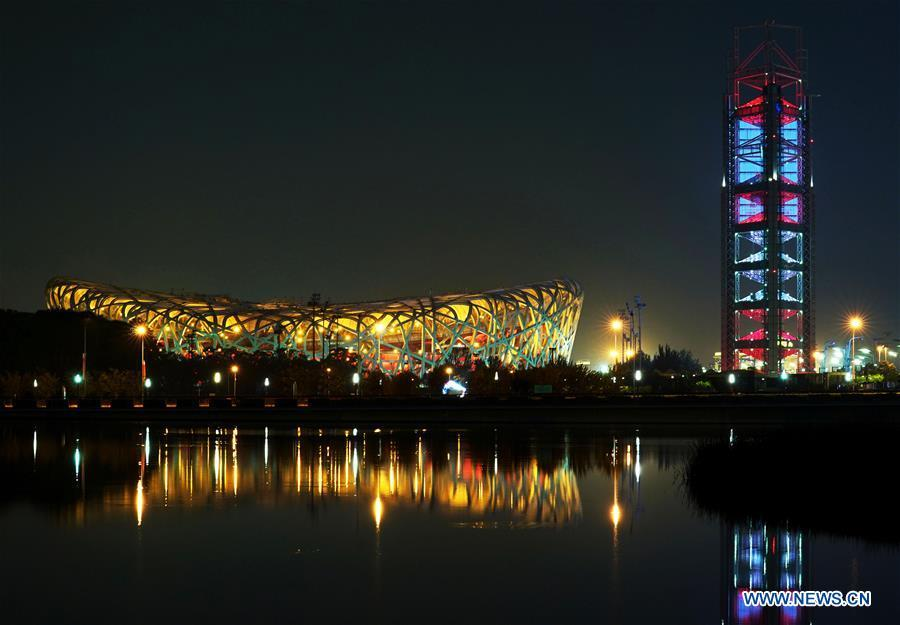 Photo taken on May 14, 2019 shows the night view of the National Stadium, also known as the Bird\'s Nest, and the Linglong Tower in Beijing, capital of China. Roads and buildings were illuminated Tuesday evening before the upcoming Conference on Dialogue of Asian Civilizations (CDAC) in Beijing. (Xinhua/Chen Jianli)