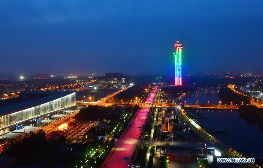 Photo taken on May 14, 2019 shows the night view of the Olympic Tower in Beijing, capital of China. Roads and buildings were illuminated Tuesday evening before the upcoming Conference on Dialogue of Asian Civilizations (CDAC) in Beijing. (Xinhua/Li He)